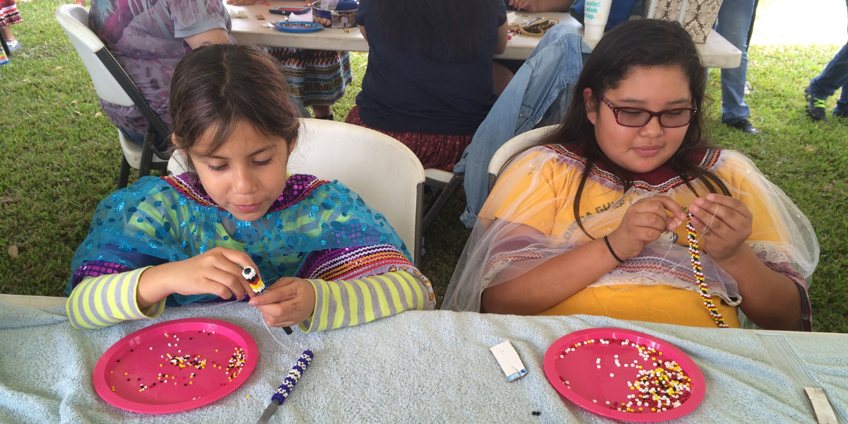 Crafting with beads at Pemayetv Emahakv Charter School