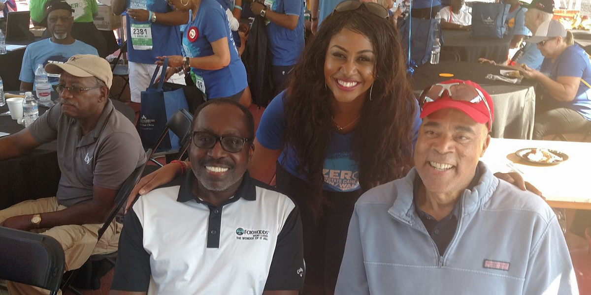 Kelsey Nelson with NBA legends Earl Monroe and Phil Chenier during the Zero Prostate Cancer Run/Walk in Baltimore.