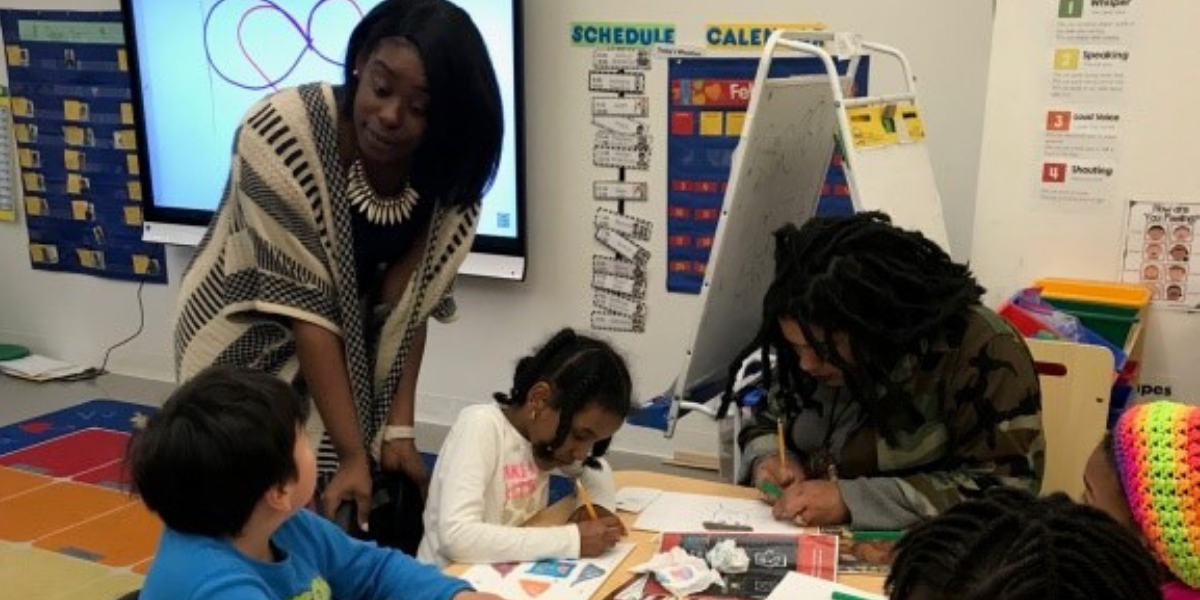 Minetre Martin, teacher at Bridges Public Charter School, with students