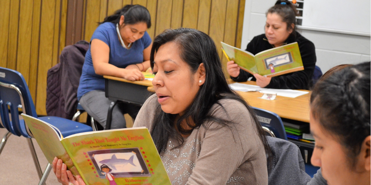 ​​​​Parent reads during Ocean Academy Charter School Latino Family Literacy Program