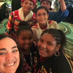 Group shot of 2019 Florida Teacher of the Year Joy Prescott with students at Pemayetv Emahakv Charter School on the Brighton Seminole Indian Reservation