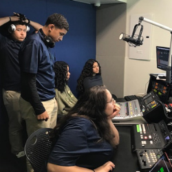 Students from Sports Leadership & Management (SLAM) Academy charter school in Miami in the studio
