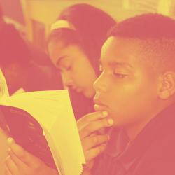 Charter school student reading overlaid with National Alliance branding